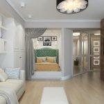 Белый шкаф у дивана