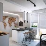 Декор в виде континентов на кухонной стене