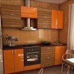 Деревянная оранжевая мебель на кухне