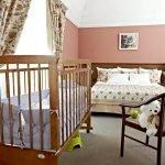Деревянная детская кроватка