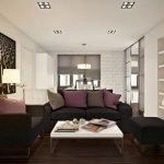 Сочетание белого столика и темных диванов